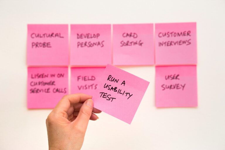 Sticky notes aligned in a grid. One says to run a usability test.